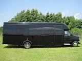 black 25 passenger executive bus